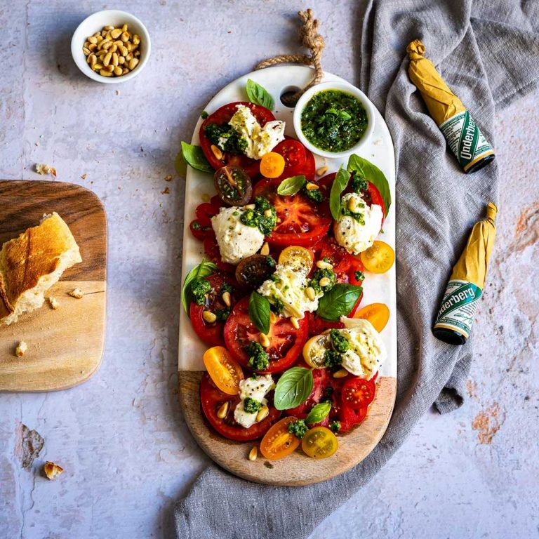 Caprese: tomato and mozzarella with herb pesto