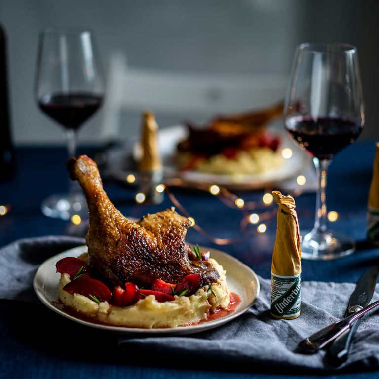 Goose legs with mashed potatoes and Underberg plums